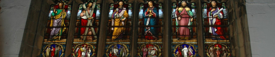 Ornate stained glass window in Haworth Church