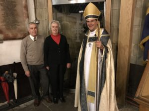 Friends of the Bronte's Church Chairman Peter Breed and Committeeman Hilatry Breed with Bishop in front of the new nortrh door that has been funded by the Friends